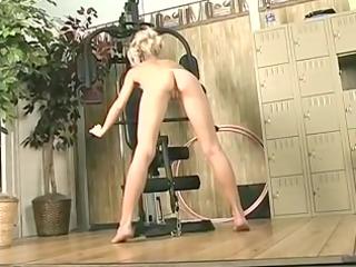 blonde girl rides long fake penis in the gym