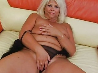 tanned golden-haired with massive bosom sticks