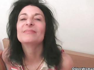 curly granny emanuelle widens her swollen cum-hole