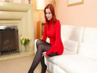 redhead in stockings disrobe in red shoes