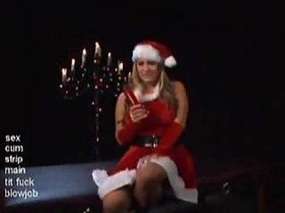 breasty mrsclaus plays with a plastic present