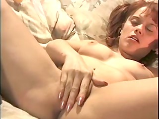 youthful redhead sticks her fingers in her