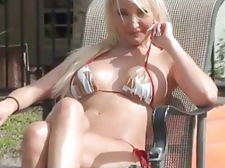 sunbathing blond drilled at the resort