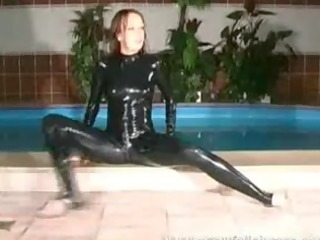 cute hottie in rubber suit widening her legs in