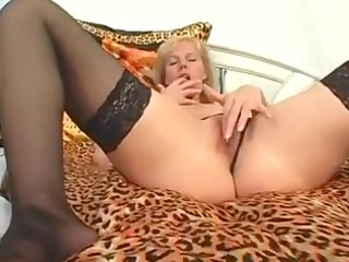 aged blonde on couch masturbates her cunt