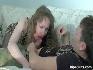 sexy and sexually excited older gal sits on hard