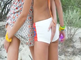 russian gals toying on the beach