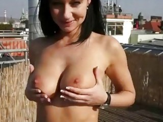 breasty brunette hair rides weenie on roofterrace