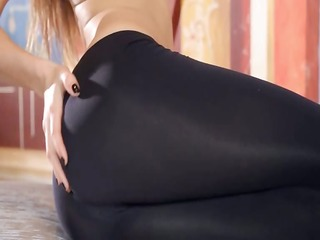 stretching her butt with steel toy