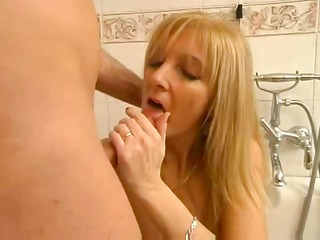 golden-haired italian mother plays with son