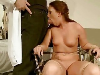 naughty redhead acquires bondaged and punished