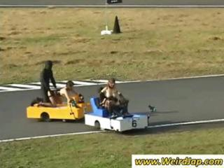 oriental sweetheart on a racing sex-toy rides it