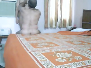 aged indian pair making love in bedroom