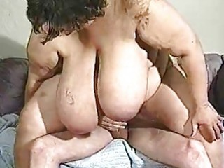 older big beautiful woman has truly large milk