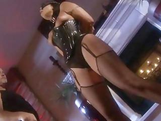 black haired pornstar in dark corset receives