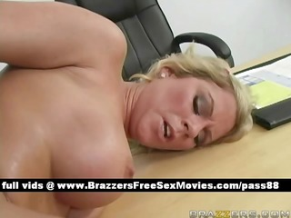 older exposed blond playgirl at work on the desk