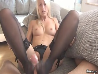 blond footjob in black stockings