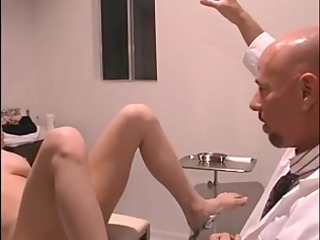 doctor inserts speculum into delightful c-cup