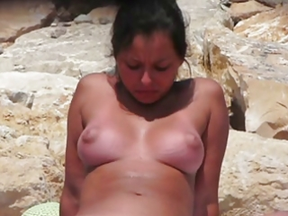 large mounds on a nudist beach