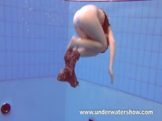 redheaded katka playing underwater
