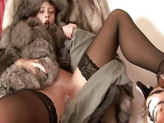 hot pale redhead in furry coat and darksome