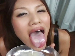 lusty oriental playgirl in dark underware drinks