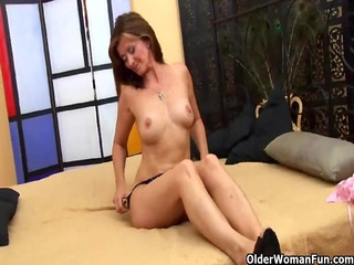 old woman sucks strapon and gets fucked