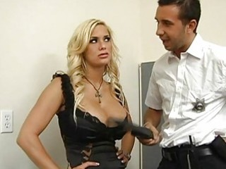 policeman searching a glamorous breasty blond and