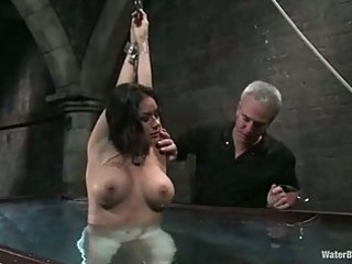 doxy nadia styles gets lowered into cold water