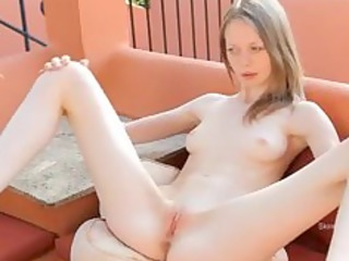 fingering thin cookie on the terrace