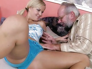 youthful golden-haired enjoying sex with grandad