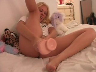 golden-haired masturbates with huge sex toy and