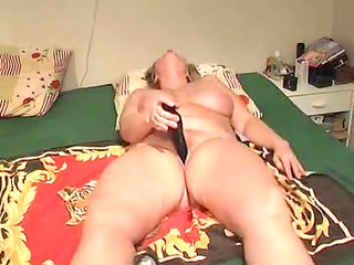 aged lady masturbates with toy during the time