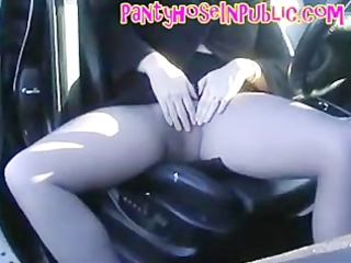 hose wife in her car in road layby fingering her