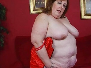 older corpulent momma in corset sticks sex tool