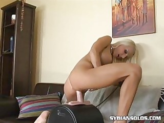 perverted blond rides a sex-toy