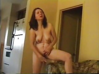 older wife masturbate standing in living room