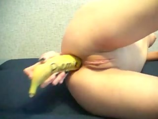 russian redhead fucking her holes with a banana