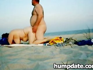 fat pair fucking on a public beach