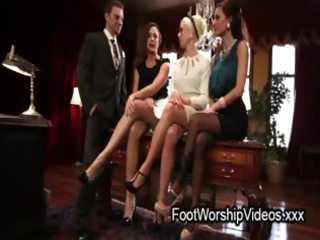 boy licking feet to secretaries