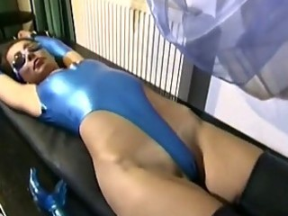 latex doxy plays with her dildo!