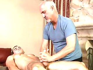 aged homosexual gives muscled dude a jock massage